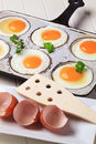 Six fried eggs in an old pan Stock Image
