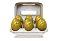 Six golden eggs in an egg carton a collection of a regular cardboard on isolated background Stock Photo