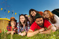 Six happy friends having rest at camping in summer Royalty Free Stock Photo