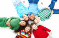 Six kids lying down in a circle Royalty Free Stock Images