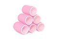 Six pink velcro rollers stacked in a pyramid Royalty Free Stock Photo