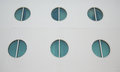 Six portholes on white hull the of a cruise ship Stock Photos