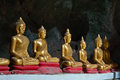 Six sitting golden buddha in the cave in thailand caveg at khao luang temple petchaburi Stock Photography
