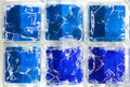 Six squares of blue cracked glass Royalty Free Stock Photo