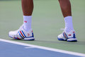 Six times Grand Slam champion Novak Djokovic wears custom Adidas tennis shoes during match at US Open 2014 Royalty Free Stock Photo