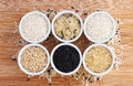 Six varieties of uncooked rice Royalty Free Stock Photo