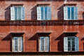 Six windows of an ancient building in Rome, Italy. Royalty Free Stock Photo