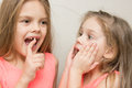 Six-year girl showing her sister loose baby tooth Royalty Free Stock Photo