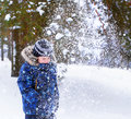The six-year-old boy costs under a snow shower Royalty Free Stock Photo