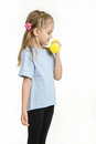 Six year old girl picked up a dumbbell with your left hand Royalty Free Stock Photo