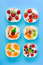 Six yogurts with fresh fruits and berries. Royalty Free Stock Photo