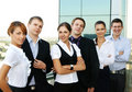 Six young businesspersons standing in a row Royalty Free Stock Images