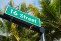 Sixteen street sign with coconut palm trees in miami beach Stock Image