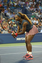 Sixteen times grand slam champion serena williams during first round doubles match with teammate venus williams at us open new Royalty Free Stock Images