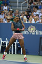Sixteen times grand slam champion serena williams flushing ny august during her first round doubles match with teammate venus Stock Photos