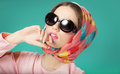 Sixties style girl beauty wearing silk scarf and sunglasses Stock Image
