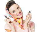 Sixties style girl holding pink lipstick over white background Stock Images