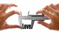The size of our love close up shot a caliper measuring word Stock Images