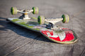 Skateboard beautiful on the cracked concrete runway Stock Photo