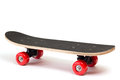 Skateboard with red wheels on white background Royalty Free Stock Image
