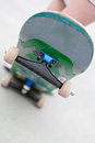 Skateboard trucks close up of a popped up showing the front and wheels shallow depth of field Stock Photography