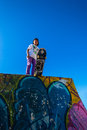 Skateboarder blue park teenage on ramp with sky at durban beachfront bike skateboard Stock Images