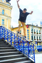 Skateboarder jumps krakow poland august teenager is practicing and performing jump tricks on stairs in krakow poland Stock Photo