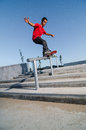 Skateboarder on rail Royalty Free Stock Photo