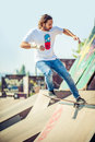 Skateboarder riding in skate park Royalty Free Stock Photo