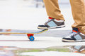 Skateboarder riding a skateboard on the street or park in close up athletic shoes sneakers Stock Photography