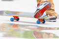 Skateboarder riding a skateboard on the street or park in close up athletic shoes sneakers Stock Photos
