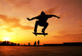 Skateboarder silhouette skateboarding at sunset beautiful scene Royalty Free Stock Photography