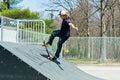 Skateboarder on a skate ramp action shot of skateboarding at the park Stock Image