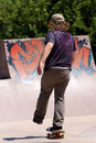 Skateboarder Skating at a Skate Park Royalty Free Stock Photography