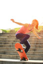 Skateboarding beautiful asian woman outdoor Royalty Free Stock Images