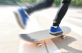 Skateboarding at city young woman modern Royalty Free Stock Photography