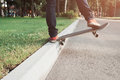 Skateboarding tricks of young hipster man Royalty Free Stock Photo