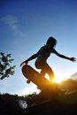 Skateboarding woman at a skateboard park Royalty Free Stock Photography