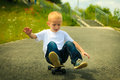 Skater boy child with his skateboard. Outdoor activity. Royalty Free Stock Photo