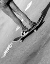 Skater close up view of a on skateboard black white Stock Photography