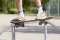 Skater doing noseslide on fun-box in skatepark Stock Images
