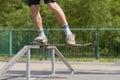 Skater doing tailside on fun-box in skatepark Stock Images