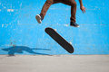 Skater jumps high in air under extrem park Stock Photos