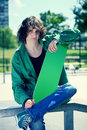 Skater posing with his skateboard Stock Images