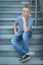 Skaterboy young boy sitting on the stairs Royalty Free Stock Image