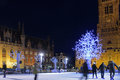 Skaters at Christmas in Grote Markt with Belfort Royalty Free Stock Photo