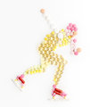 Skating and drugs doping pills in the shape of a speed ice skater running on ice Royalty Free Stock Photo