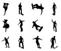 Skating skateboarder silhouettes skateboarders performing lots of tricks on their boards very high quality detailed silhouette Royalty Free Stock Image