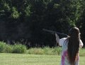 Skeet shooting a teenage brunette girl a gauge shotgun this photo was taken at a nra youth sporting event Stock Image