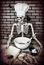 Skeleton cooking a up a frightful meal textured Stock Photo
